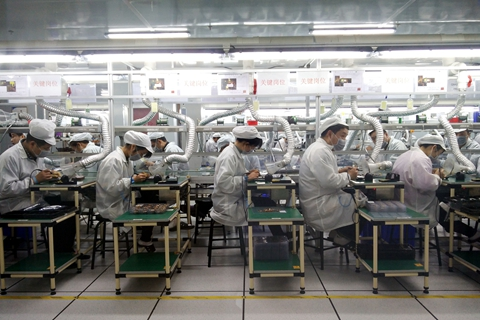 China exported 130 million mobile phones valued at $31.2 billion to the U.S. in 2017. Above: a mobile phone assembly line in China. Photo: VCG