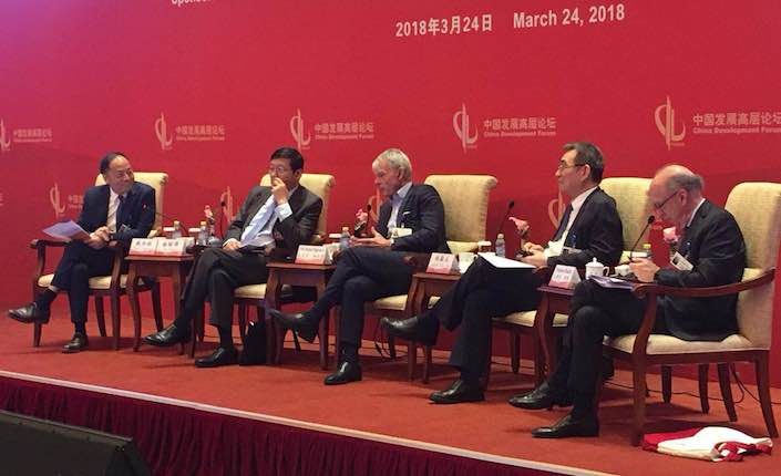 At the China Development Forum in Beijing on Saturday, former Chinese Finance Minister Lou Jiwei (second from left) said the U.S. and China should come together and talk out their differences. Photo: Michael Bellart/Caixin