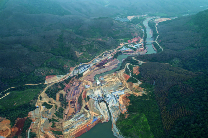 A swath of tropical rainforest on the Xiaohei River in South China's Yunnan province has been cut down to make way for the Huilongshan Hydropower Station. Liang Yingfei/Caixin