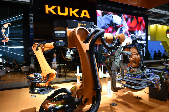 German manufacturer Kuka displays industrial robots at the China International Industry Fair in Shanghai in November 2015. Photo: VCG