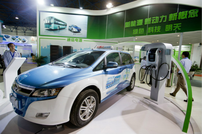 BYD Co. Ltd. displays an electric taxi and vehicle-charging equipment in Beijing in June 2013. Photo: VCG