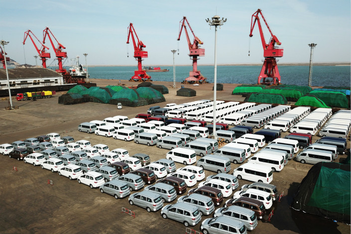 Domestically made cars await export at the port of Lianyungang, Jiangsu province on March 5. Photo: VCG