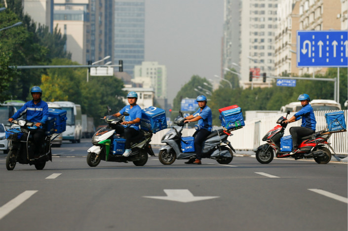 Drivers for takout service Ele.me start delivering breakfast to hungry Beijingers on the morning of Sept. 21. Photo: VCG