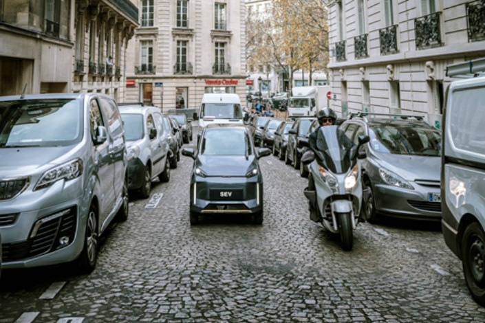 A Chehejia low-speed small electric-vehicle, or SEV, drives down a Paris street. Photo: CHJ Automotive
