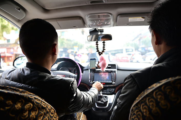 A Didi Chuxing driver takes a passenger to their destination in Zunyi, Guizhou province in 2016. Photo: IC