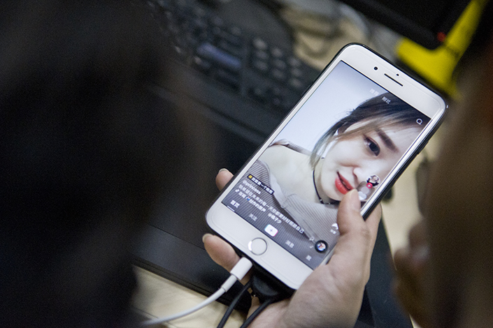 A viewer watches a short video on the Tik Tok mobile app, the overseas version of the Douyin video-streaming mobile app, which is operated by Jinri Toutiao's parent company. Photo: IC