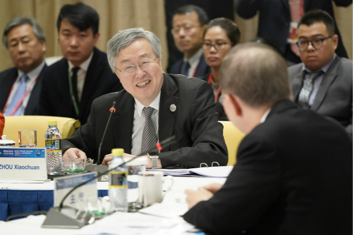 Zhou Xiaochuan (center) was elected vice chairman of this year's Boao Forum for Asia. Photo: VCG