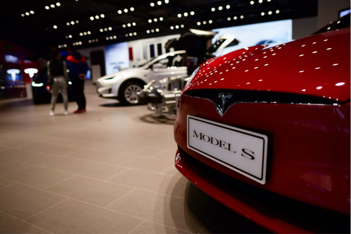 Tesla Inc. vehicles are displayed in a Beijing showroom on Monday