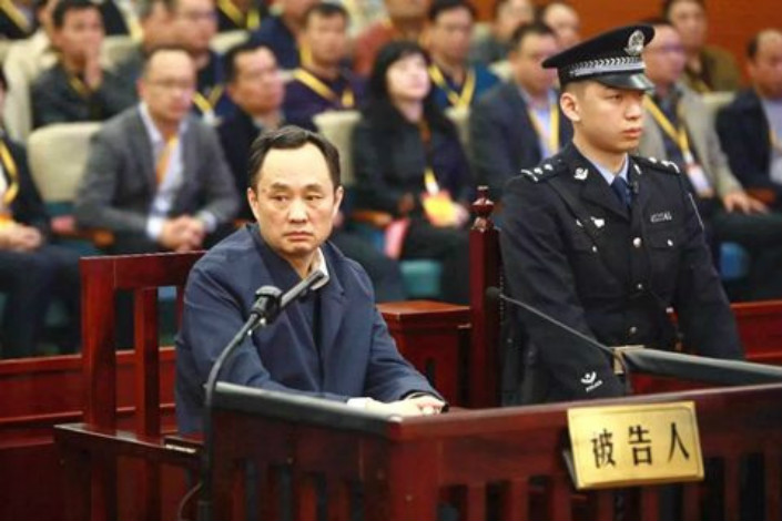 Zhang Wenxiong, director of the Publicity Department of Hunan's provincial party committee, stands trial on Tuesday in Guilin Intermediate People's Court. Photo from Guangxi High People's Court