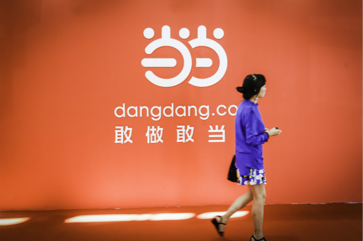 Dangdang Chairman Li Guoqing and his wife, Yu Yu, will own a combined 16.49% of Tianjin Tianhai Investment Co. Ltd. after Tianjin Tianhai acquires Dangdang. Photo: VCG