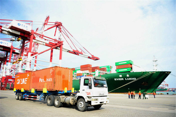 A truck transports containers to be shipped abroad at the Port of Qingdao, in east China's Shandong province, on April 13, 2018. Photo: IC