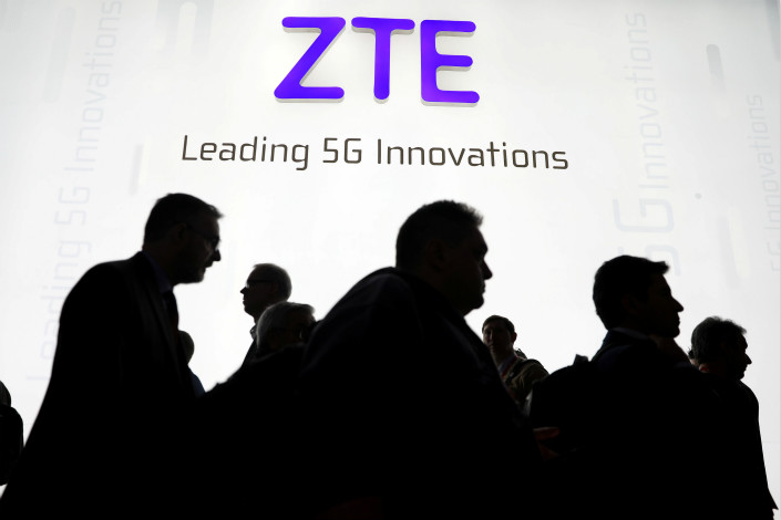 Visitors pass in front of ZTE's booth at the Mobile World Congress in Barcelona, Spain, on Feb. 26. Photo: VCG