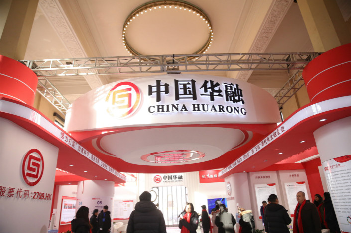 Attendees of a finance expo in Beijing visit the stand of China Huarong Asset Management Co. on Jan. 25. Photo: IC