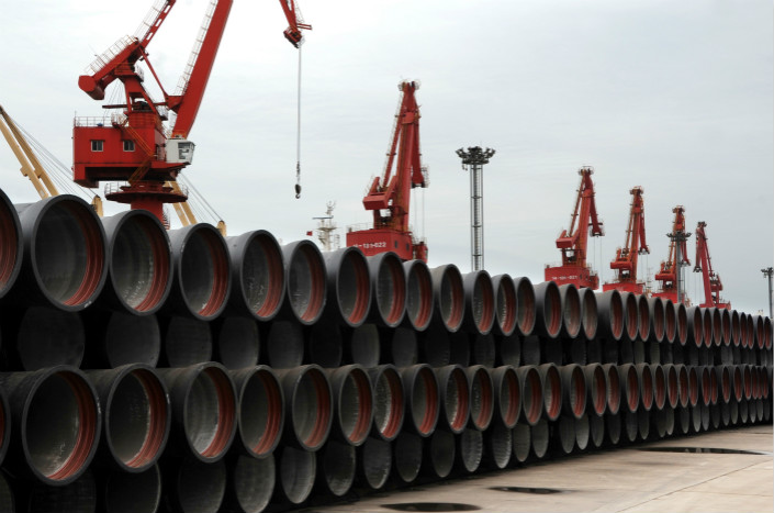 Stacks of cast steel pipes on Friday await shipment abroad at a port in eastern China's Jiangsu province. Photo: VCG