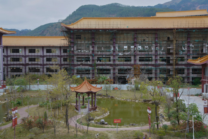 The China Classic Industrial and Art Exhibition City is seen in Xianyou county's Bangtou town. Construction of the 57-acre site began in August 2011. Now the project, with a budget of 2.1 billion yuan ($334 million), is still incomplete because the developers are rumored to have fled overseas after heavy losses from the project. Photo: Caixin/Liang Yingfei