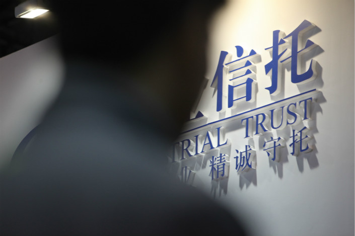 "The president of a state-owned trust company told Caixin he thought it would be ""very difficult"" for firms to exit all nonstandard asset investments financed by funding pools in three years, as regulators want. Photo: VCG"