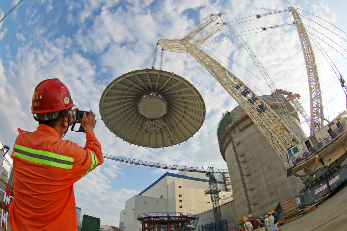 A worker takes pictures of construction at the Haiyang Nuclear Power Plant in Haiyang, Shandong province, in September 2015. Photo: IC