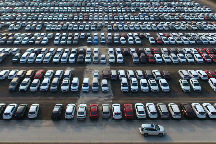 Cars are parked in FAW Car Company Ltd.'s new car parking lot in Zhengzhou, Henan province on Oct. 18. Photo: VCG
