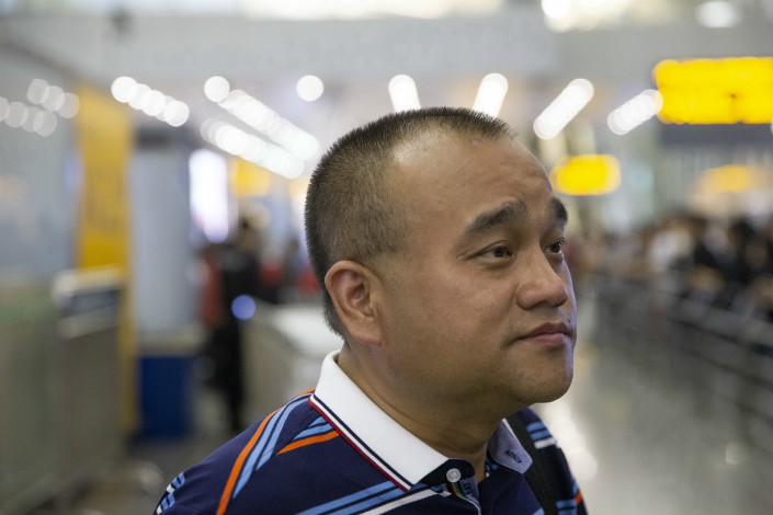 """Chinese doctor Tan Qindong, who was detained for three months for calling Hongmao Medicinal Liquor """"poison from heaven,"""" is seen at Guangzhou Baiyun International Airport in Guangzhou, Guangdong province on April 19. Photo: IC"""