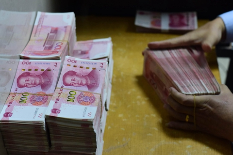 The yuan dropped Tuesday to hit its lowest in almost a year. Photo: VCG