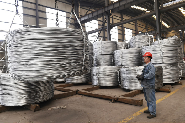 A worker stacks aluminum wire at a factory in Zouping county, Shandong province on April 18. Photo: IC