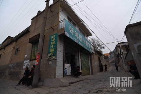 A small shop run by Wang Cailin became a shelter for more than a dozen students as the attack occurred. Photo: Ding Gang/Caixin