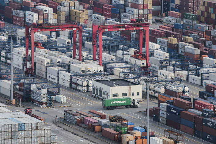 Trucks wander the maze of containers at the port of Yangshan in Shanghai on March 29. Photo: IC