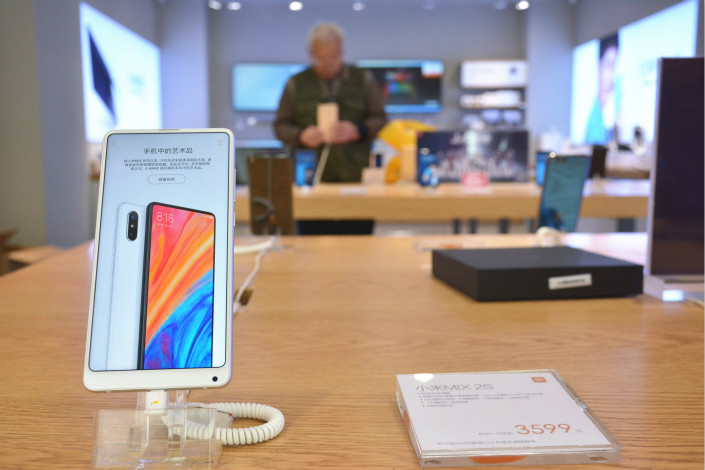 Xiaomi Corp. smartphones are displayed at a company store in Handan Hebei province on March 28