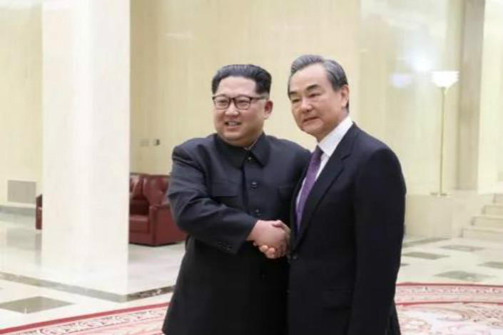 Chinese State Councillor Wang Yi (right) meets with North Korean leader Kim Jung Un in Pyongyang on Thursday. Photo: VCG