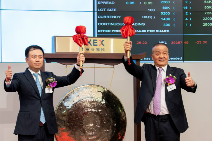 Ping An Good Doctor CEO Wang Tao (left) and Ping An Group CEO Ma Mingzhe attend the listing ceremony for Ping An Good Doctor on the Hong Kong Stock Exchange on Friday. Photo: IC