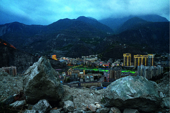 Jagged rocks left by the earthquake overlook Wenchuan's county seat at night on Jagged rocks left by the earthquake overlook Wenchuan's county seat at night on April 12, 2018. Photo: CaixinApril 12, 2018. Photo: CaixinJagged rocks left by the earthquake overlook Wenchuan's county seat at night on April 12, 2018. Photo: Caixin
