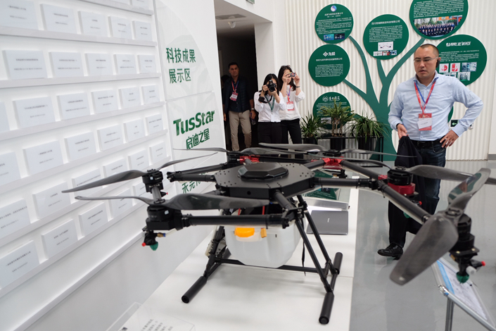 A technology business incubator center in Chengdu displays a farming drone on April 23. Photo: Wu Gang/ Caixin