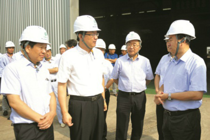 Pei Xiping, general manager of Yangquan Coal (pictured third from left), gives a provincial official a tour of the company in August. Photo: Yangquan Coal