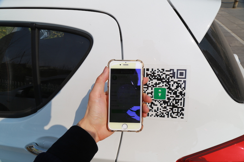 A user unlocks a shared car via mobile phone in Jinan, Shandong Province. Photo: VCG
