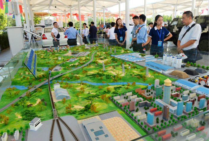 A Wuyi exhibition in Beijing features a miniature industrial park and railway. Photo: VCG