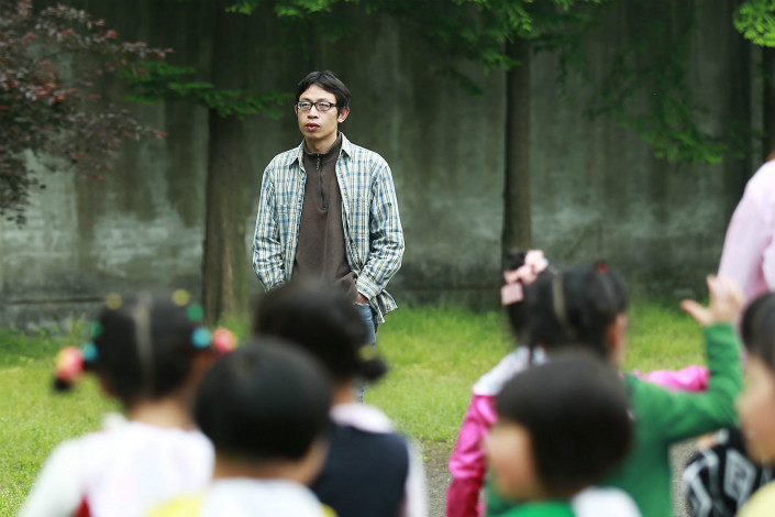 Fan Meizhong teaches at a school in Chengdu in April 2014. Photo: VCG