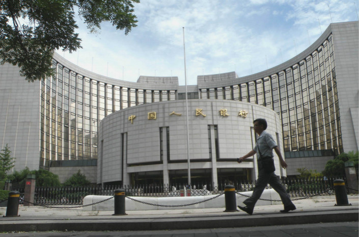 The People's Bank of China (above), China' central bank, is signaling a decreased emphasis on deleveraging in its monetary policy, experts said. Photo: IC