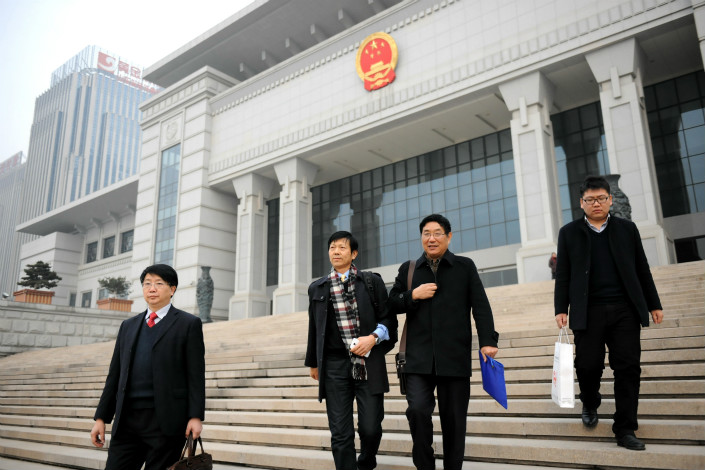 Lawyers leave the Shandong provincial high court on Dec. 15, 2014, after failing to access Nie Shubing's files at the court. Photo: VCG