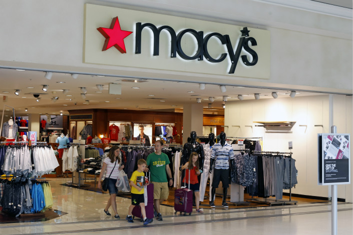 Customers leave a Macy's department store in the U.S. on July 31. Photo: IC