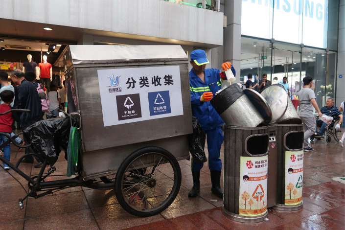 Garbage is collected in Shanghai's Nanjing Road pedestrian street on May 1. Photo: VCG