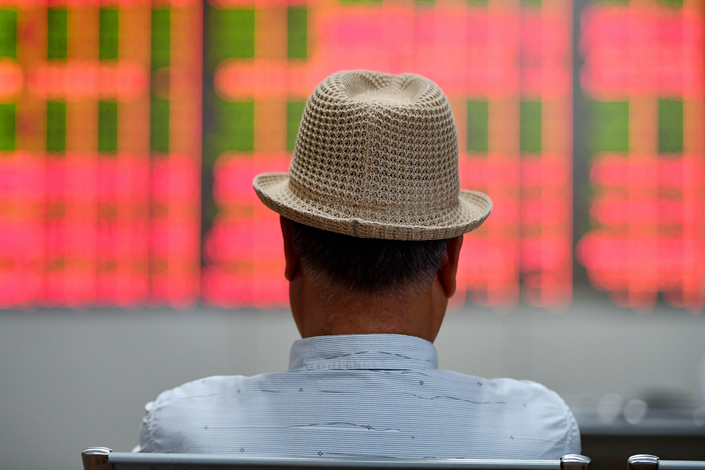 A man watches stock price changes at a securities brokerage in Jinhua, Zhejiang province on May 17. Photo: VCG