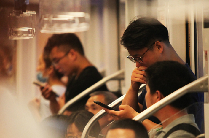 Passengers use their smartphones on a subway train in Nanjing, Jiangsu province. Photo: IC