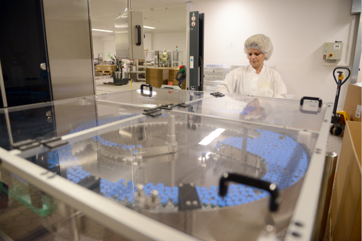 A Takeda employee processes medication at a facility in Singen, Germany. Photo: IC