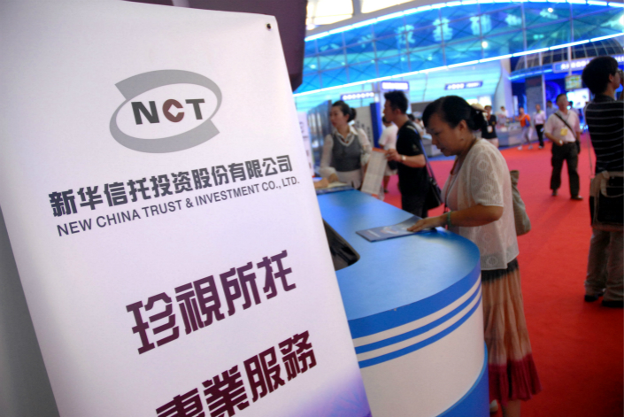Conglomerate Tomorrow Holdings' plan to sell its stake in New China Trust could face problems due to the recent financial difficulties of the potential buyer. Photo: VCG