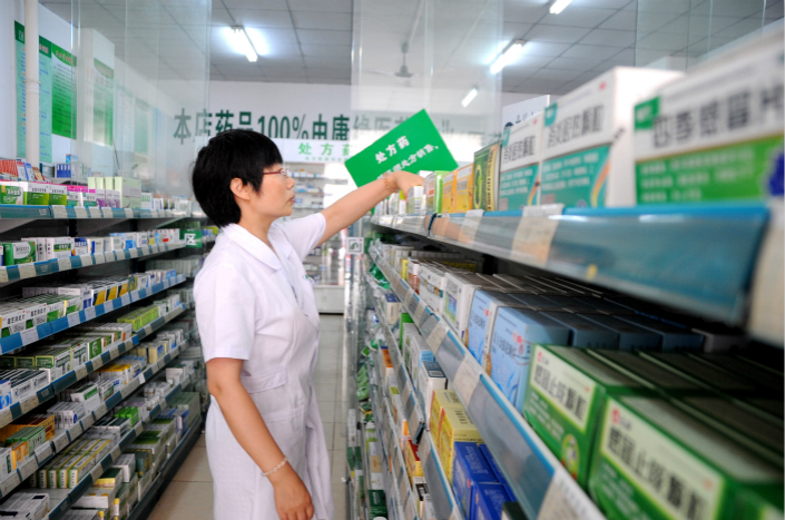 An employee of a drugstore in Lianyungang, Jiangsu province, sorts medicines on July 1. Photo: VCG