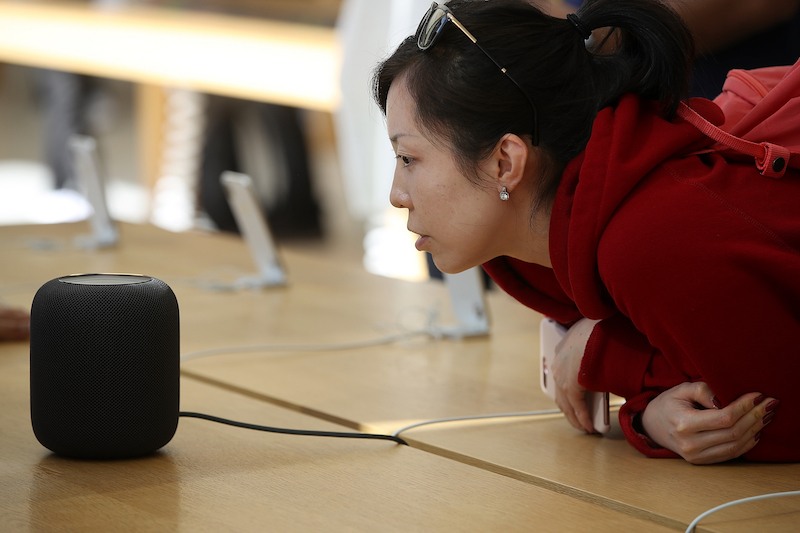 A customer tests the newly released Apple HomePod smart speaker in February. Photo: VCG