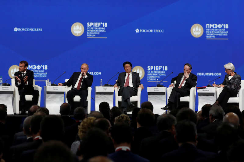 French President Emmanuel Macron, Russian President Vladimir Putin, Japanese Prime Minister Shinzo Abe, Chinese Vice President Wang Qishan and IMF Managing Director Christine Lagarde attend a session of the St. Petersburg International Economic Forum on Friday. Photo: Reuters