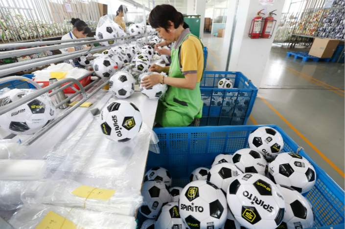 Workers package soccer balls on May 15 at a sports equipment factory in Nantong, East China's Jiangsu province. Photo: VCG