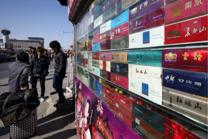 Cartons of cigarettes are displayed at a kiosk outside Beijing West Railway Station in 2013. Photo: VCG