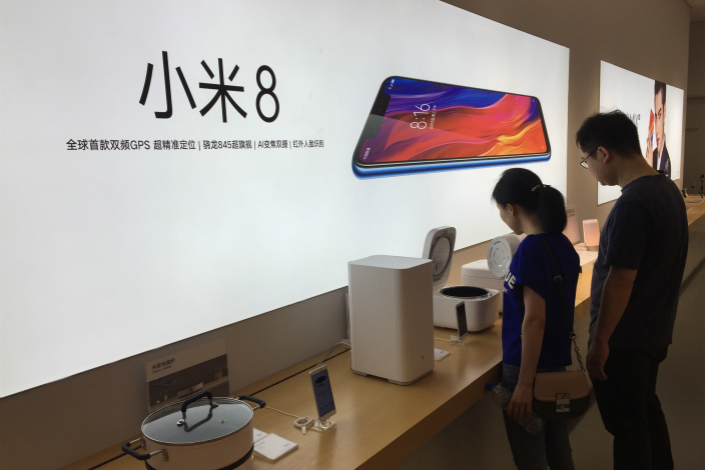 An advertisement for Xiaomi Inc.'s new Mi 8 cellphone is seen in a store in Wuhan, Hubei province, on Sunday. Photo: VCG